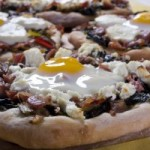 Pizza with swiss chard, prosciutto and egg.