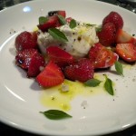 Salad of strawberries and fresh burrata cheese.