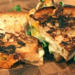 Grilled 3-cheese and arugula sandwich.