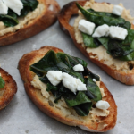 Crostini with hummus and chard.