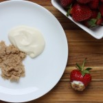 Strawberries with creme fraiche and brown sugar.