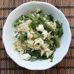 Orzo pasta salad with seasonal vegetables.