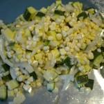 Grilling summer vegetables in foil.
