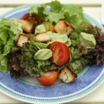 Summer salad with avocado dressing and biscuit croutons.