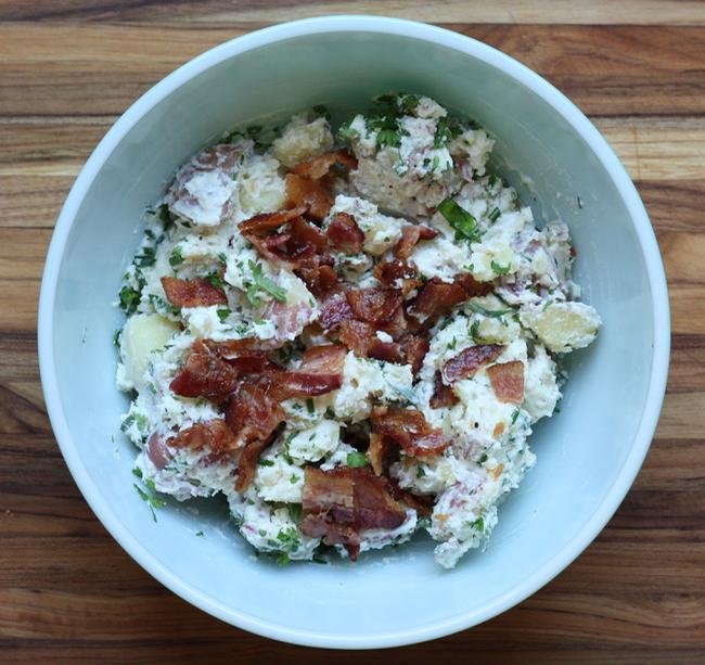 smashed potato salad with bacon and fresh herbs recipe | writes4food.com