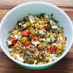 Whole grain salad with tomatoes and corn.